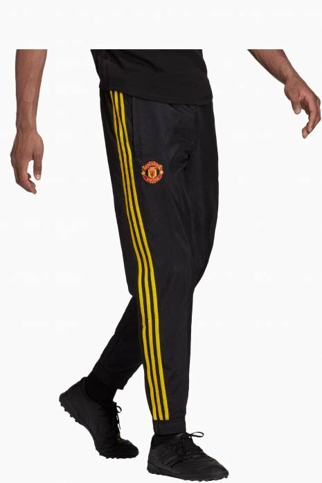 Nohavice adidas Manchester United 21/22 ICON WOVEN